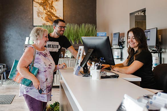 Chiropractic Council Bluffs IA Front Desk with Patient
